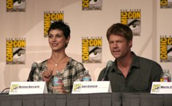 Actors Morena Baccarin and Joel Gretsch speak during the