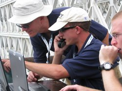 Students from the U.S. Naval Academy calculate how their submersible should b...