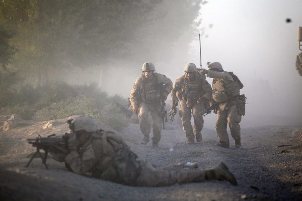 Marines with the 2nd Marine Expeditionary Brigade, RCT 2nd Battalion 8th Marines Echo Co. move into position while they were under enemy fire in Mian Poshteh, Afghanistan.