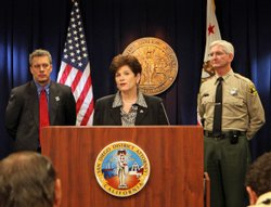 San Diego County District Attorney Bonnie Dumanis, flanked by FBI Special Agent-in-Charge Keith Slotter and San Diego Sheriff Bill Gore, announces charges against a cross-border kidnapping and murder organization.