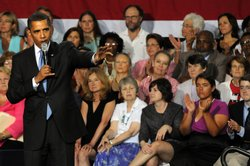 President Barack Obama speaks at a town hall meeting about the need for health care reform to a crowd of 1,800 on August 11, 2009 in Portsmouth, New Hampshire.