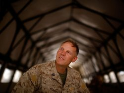 The Marine battalion's chaplain, Navy Lt. Terry Roberts, sits in a supply ten...