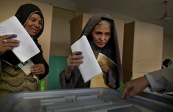 Afghan women cast their ballots at a local mosque used as a polling station A...