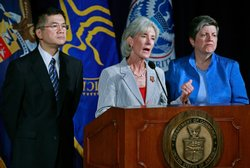 Commerce Secretary Gary Locke (L), HHS Secretary Kathleen Sebelius (C) and Ho...