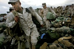 Marines pick up their belongings during a homecoming ceremony on October 4, 2...