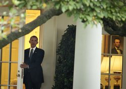 President Barack Obama leaves the Oval Office and walks to Marine One on the ...