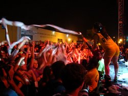 A modified leaf blower covers the crowd in toilet paper at Girl Talk's show a...