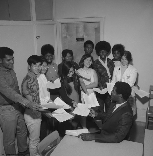 Students present essays to Dr. Ernest Hartzog, the first African-American principal in San Diego.