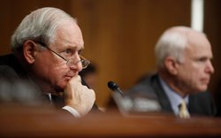Senate Armed Services Committee Chairman Carl Levin (D-MI) (L) and ranking member Sen. John McCain (R-AZ) listen to testimony from Chairman of the Joint Chiefs of Staff U.S. Navy Admiral Mike Mullen during his reappointment hearing September 15, 2009 in Washington, DC.