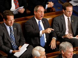 Rep. Joe Wilson (R-SC) shouts as President Obama addresses a joint session of...