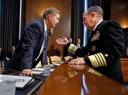 Adm. Mike Mullen, chairman of the Joint Chiefs of Staff, talks with Sen. Lind...