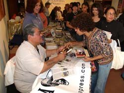 Luis Rodriguez signs autographs at last year's San Diego City College International Book Fair.