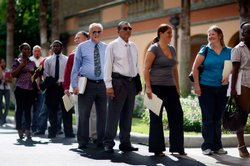 People stand in line at the Diversity Job Fair on September 24, 2009 in Davie...