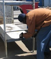 Prison inmate learns vocational skills at the prison's welding yard.