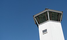 A tower overlooks the prison grounds.