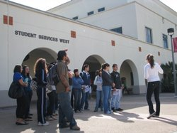 Prospective SDSU students take a tour on campus from a student representative.