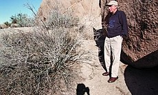 Judith Fox describes her husband as a natural athlete. Here he pauses in the shade of a rock on a hiking trail.