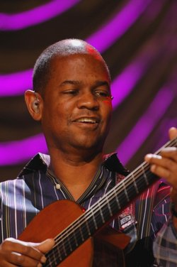 Jazz guitarist Earl Klugh plays his acoustic guitar on stage.