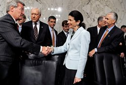Senate Finance Committee Chairman Max Baucus (D-MT) (L) thanks Sen. Olympia Snowe (R-ME) (C) for voting in favor of health care reform legislation as committee Republicans Sen. Orrin Hatch (R-UT) (2nd L) and Sen. John Ensign (R-NV) (R) watch, on Capitol Hill October 13, 2009 in Washington, DC.