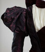 Well-known concert pianist, Ora McCuthen, made this dress, a variation on the leg o' mutton sleeve, with a small puff at the shoulder. Living in San Diego County her whole life, McCuthen often designed and sewed her own clothing.