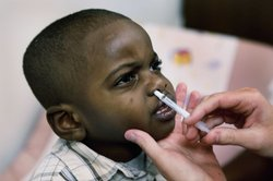 Isiah Harris receives an H1N1 influenza vaccine at Rush University Medical Center October 6, 2009 in Chicago, Illinois.