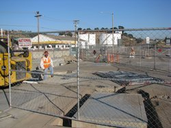 Workers clean up groundwater contamination under the parking lot of Qualcomm Stadium on October 20, 2009.
