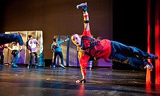 "David Henry, co-artistic director of Culture Shock San Diego, shows off his breakdancing moves in the company's ""Graffiti Life."""