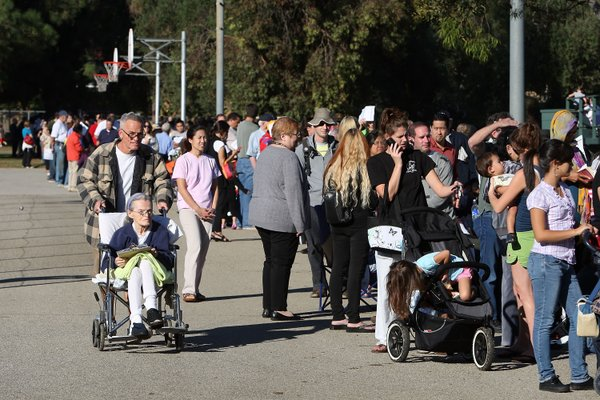 Hundreds of residents line up for H1N1 vaccinations during the launch of the first Public Health H1N1 vaccine clinics in Los Angeles County on October 23, 2009 in the Los Angeles area community of Encino, California.