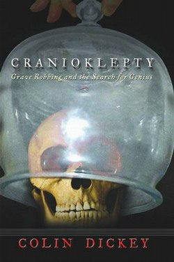 "Featuring a skull enshrouded by a glass encasement, the book cover for ""Cranioklepty: Grave Robbing and the Search for Genius,"" gives a glimpse into the morbid details of grave robbing."