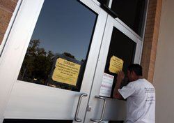 A California Department of Motor Vehicles customer peers into the door of a D...