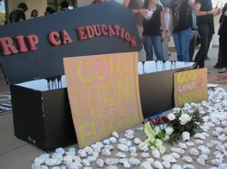 A fake coffin made by SDSU art students symbolizes cuts to higher education.