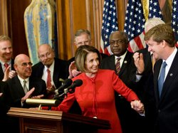Pelosi takes Rep. Patrick Kennedy's hand at a news conference at the U.S. Cap...
