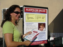 Liliana Osorio hands out information about the H1N1 virus at a Latino Health Fair in Escondido.