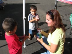 Liliana Osorio talks to kids about the importance to using alcohol-based hand cleaners to prevent the spread of germs.