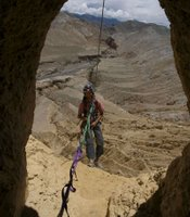 Climber Renan Ozturk, rappeling out of a cave in Upper Mustang, Nepal.