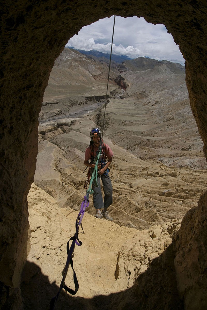 Climber Renan Ozturk, rappeling out of a cave i...