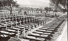 Black and white photo of a WWII temporary cemetery.