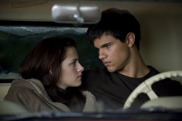 "Kristen Stewart and Taylor Lautner (as the werewolf Jacob) in ""New Moon"""