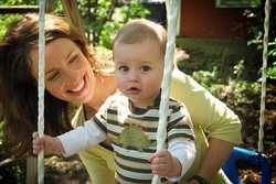 Melissa pushes her son Benjamin on a swing.