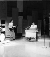 "The Doors sing  their chart-topping ""Light My Fire"" in their infamous one-time-only appearance Sullivan's show."