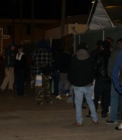 People begin lining up at 7 p.m. to get a bed by lottery in the winter homeless shelter on Island and 16th Street on December 4, 2009.