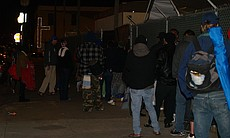 People begin lining up at 7 p.m. to get a bed by lottery in the winter homele...