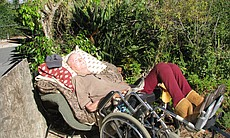 Michael Condon, who uses In-Home Supportive Services, rests in his wheelchair outside his home. After his diving accident, he is unable to feed, bathe or dress himself.