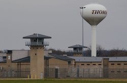 A guard tower and prison yard remains empty at the Thomson Correctional Cente...