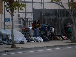 People pack-up their belongings after staying the night on the street on December 5, 2009.