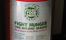 A barrel of donated food sits at the San Diego Food Bank waiting to be sorted.