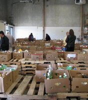 Charity volunteers pick out food items at the Food Bank's warehouse on December 17, 2010 in San Diego, California.