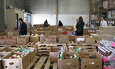 Charity volunteers pick out food items at the Food Bank's warehouse on Decemb...