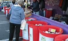 Bernadette Perkins drops off items at the San Diego Food Bank food drive at a Vons grocery store in Imperial Beach.