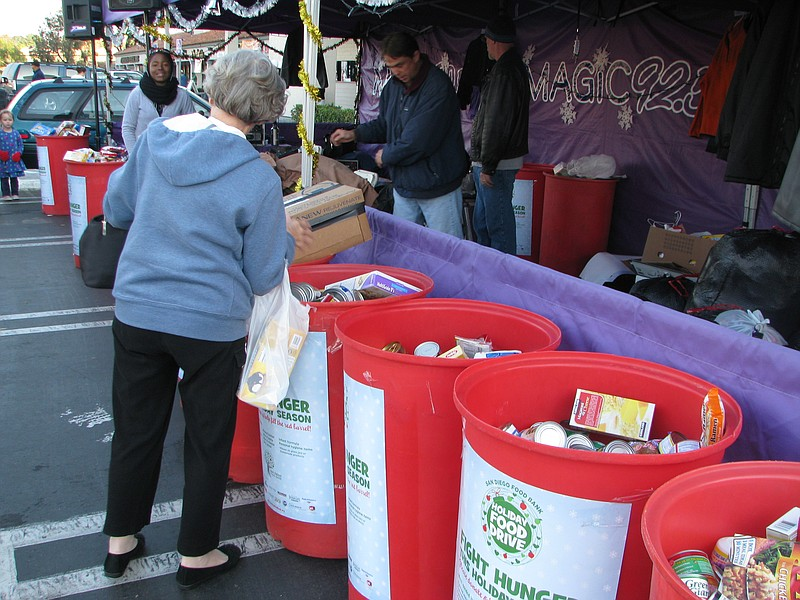 Bernadette Perkins drops off items at the San Diego Food Bank food drive at a...